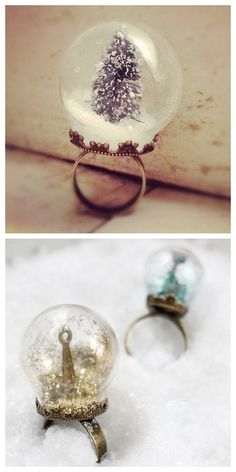 Buy or DIY Snow Globe RingsTop Photo: $20 Pine Tree Snow Globe from ingredientsforlovely here. Bottom Photo: DIY by Henry Happened. For more snow globe DIY jewelry: Mini Snow Globe Vial Pendant here. Snow Globe Necklace here.Could you take a mini clear ornament and flip it, glue it and fill it for the same look?