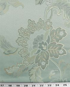 Medium Weight Drapery / Medium Weight Upholstery A traditional jacquard floral with light neutral shades (ivory, gold, beige, tan) on a light icy-blue background. Big flowers are about 7