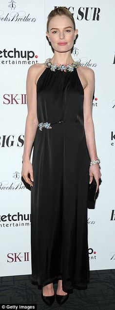 Pure elegance: Kate Bosworth showed off her slender frame in a floor-length black gown that featured silver embellishments.  Love the jewels!