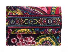 Vera Bradley Euro Wallet in Symphony in Hue by Vera Bradley. $24.99. This wallet is  compact-but-spacious style. A sleek, modern design includes eight handy card slots. Very continental, it features an expanded bill compartment that fits euro currency. Outside, there's a double snap closure and a zippered back pocket.