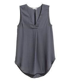 Gently flared, sleeveless blouse in airy crêpe with a V-neck with a pleat centre front and a rounded hem. Slightly longer at the back. The blouse is made pa Stylish Dress Designs, Looks Plus Size, Professional Wardrobe, Sleeveless Blouse, Grey Blouse, Fashion Company, Nice Tops, Dress Patterns, Blazer Outfits
