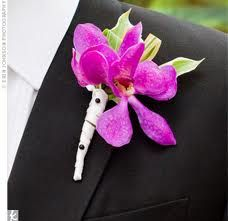 The groom's boutonniere will be a bright pink dendrobium orchid with small green leaves wrapped in ivory ribbon with the stems showing.