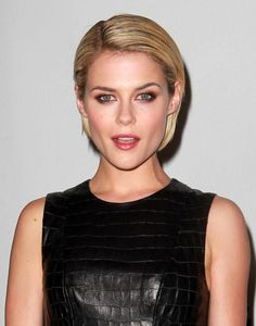 Rachael Taylor's Slicked Down Bob  Step: Towel dry hair. Use a comb to create a deep side part.    Step: Apply defrizz serum for smoothness. Blowdry from roots to ends with a flat paddle brush, to create a sleek look with no flyaways.    Step: Apply hair gel and comb it through hair, combing hair behind the ears.