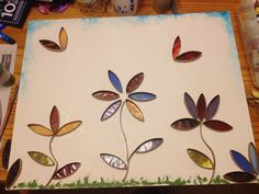 Cut up empty toilet paper rolls and old magazine pages, get a canvas, acrylic paint, and tacky glue.  Make a scene!