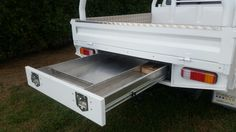 Aluminium Ute tray powdercoated white sliding drawer, 70lt water tank incorporated into the headboard. Tray extended to fit dirt bikes.