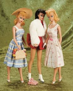 Three Ponytail Barbies by Mattel in original Barbie tagged costumes