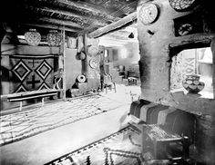 Mary Colter interior decoration in Hopi House. Pot in window. Rug on loom. Circa 1905