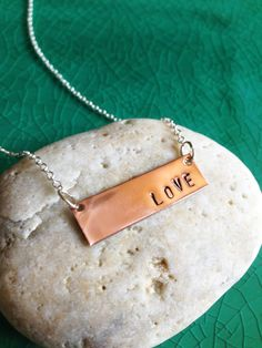 I love the rusticity of this pendant necklace. Handstamped LOVE Copper Metal Tag on a by LilMissGraceJewelry