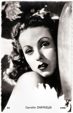https://flic.kr/p/JSJ8KT | Danielle Darrieux | French postcard by Edition Chantal, Rueil, no. 96. Photo: x.phot.  French actress and singer Danielle Darrieux (1917) is an enduringly beautiful, international leading lady. From her film debut in 1931 on she progressed from playing pouty teens to worldy sophisticates. In the early 1950s she starred in three classic films by Max Ophüls, and she played the mother of Catherine Deneuve in five films!   For more postcards, a bio and clips check out…