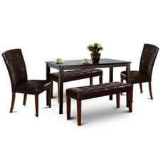 Round Black Glass Dining Table With Single Legs And Four Plastic