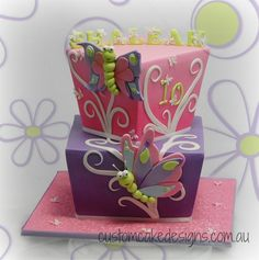 - I have made numerous cakes for this gorgeous family and this time Shaleah is turning 10    The brief for this cake was that the cake had to have 1 pink and 1 purple tier and that the birthday girl loves butterflies. The rest was up to me as to what I wanted to design and as she likes 'different' cakes, I came up with this ...