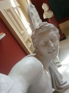 Statues Look Like They're Taking Selfies