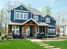 """The Clover won """"Best Curb Appeal"""" at the 2013 Homearama. If you click into this website you will be able to view a video produced by Young House Love Blue Siding, Exterior Siding, Exterior Design, Wood Siding, White Siding, Home Styles Exterior, Cafe Exterior, Wood Facade, Restaurant Exterior"""
