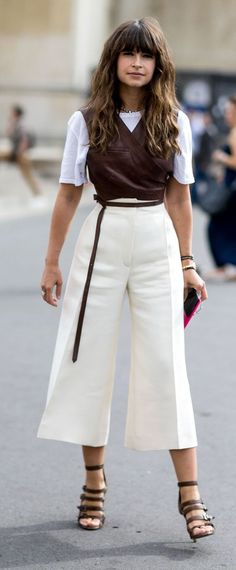Miroslava Duma rocks a leather top and white culottes during fashion week.