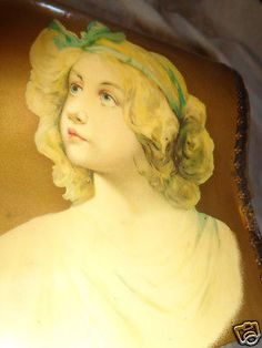 """ANTIQUE-VICTORIAN-BEAUTIFUL-GIRL-PORTRAIT-ROLL-TOP-CELLULOID-COLLAR-DRESSER-BOX. BIN: $145 + $18.64. --- This is an old Victorian era celluloid top and celluloid sides of an angelic looking child. The box is 6"""" by 6 1/4"""" by 5 1/2"""" tall. It is in nice condition but does have a right top edge 3/8"""" by 1"""" long edge chip to celluloid. On the left side the top edge of the celluloid has very slight lifting. It has original lining with a collar inside. This is in good condition. You should love it…"""