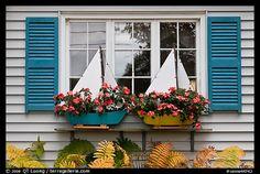 Window with flower pots shaped like sailboats. Bar Harbor, Maine