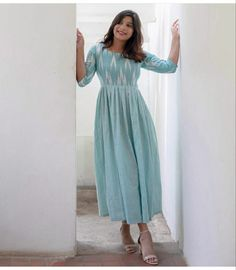 Shop online Sky blue ikat dress Featuring this light blue ikat yoke with plain pleated flare and a pear shaped opening at the back which is a must have in your collection. Kalamkari Dresses, Ikkat Dresses, Long Gown Dress, Frock Dress, Designs For Dresses, Dress Neck Designs, Casual Frocks, Casual Dresses, Indian Designer Outfits