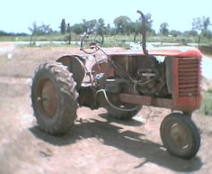 I used to ride on a similar tractor as a kid, I miss those days!