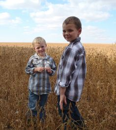 brothers sibling photo in a bean field at harvest time in Iowa brother photo ideas