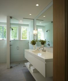 Green Glass Tile and Ivory Bath in Spa Style, Remodelista Like the no-transition from shower to bathroom floor and the glass doors... Grey Bathroom Tiles, Grey Floor Tiles, Bathroom Spa, Bathroom Interior, Modern Bathroom, Bathroom Ideas, Bath Ideas, White Bathroom, Bad Inspiration