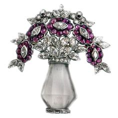 Art Deco Rock Crystal Ruby Diamond Platinum Brooch | From a unique collection of vintage brooches at https://www.1stdibs.com/jewelry/brooches/brooches/