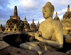 Buddha Gautama inside the stupas of The Borobudur temple. Central Java,Indonesia.