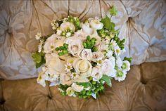 All cream design with roses.    By Jen-Mor Florist, Dover, DE www.jenmor.com