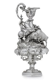 THE QUEEN'S CUP, ASCOT, 1861: A VICTORIAN SILVER TROPHY MARK OF R & S GARRARD, LONDON, 1848; THE DESIGN ATTRIBUTED TO EDMUND COTTERILL Of ewer form, on circular foot chased with fruit, the baluster stem with three beaded scroll brackets, the lobed bowl chased with strapwork and applied with pendant fruit and flowers, the removable upper section formed as grassy hill set with a buffalo hunt, two Indians on horseback, sold for 194,000 Gbp