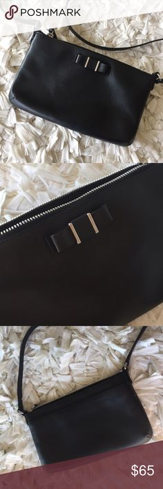 COACH dusty bow cross body!! Simple bag and so chic! Sad repost, but hope it will find a good home soon! It's a must have for any closet! It will go with every outfit! Excellent, used once condition. Slip pocket on back. One slip pocket on the inside. Small leather bow in front. 9.5 inches wide and 5.5 inches tall. Adjustable cross body! Coach Bags