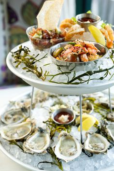 Seafood Tower - mollusks, shellfish, finfish; marinated, raw and cooked, accoutrements