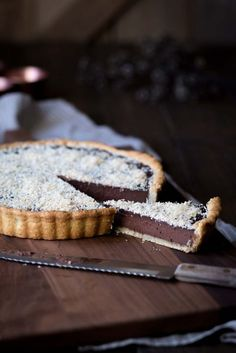 This Bittersweet Chocolate Tart with Toasted Coconut and Sea Salt is rich, decadent and perfect for parties. It's a chocolate tart recipe with a twist. Tart Recipes, Sweet Recipes, Dessert Recipes, Dessert Ideas, Sweet Pie, Sweet Tarts, Just Desserts, Delicious Desserts, Sweet Desserts