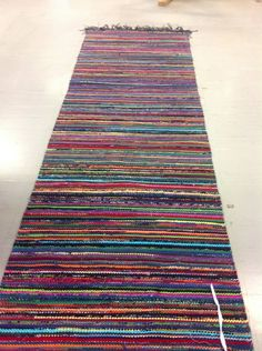 A gorgeous rug with faded/soft colours. In lovely condition. Handwoven in the has had one owner. No fridging at the ends. Machine washable at 30 degrees, hang to dry. All vintage rugs have had a life and are not brand new.
