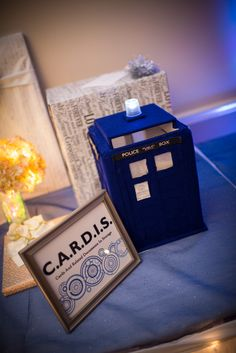 "Homemade ""CARDIS"" TARDIS Card box for my wedding in September with instructions via http://nadinestudio.com/wedding/tardis-card-box-tutorial-diy-austin-wedding-photographers/# Whovian Doctor Who Wedding Idea"