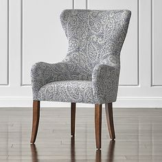 Galloway holds court at the head of the table as a stately host chair. Tailored in a modern blue paisley, this classic wing dining chair sits upright and polite but is plenty comfortable for multiple courses and conversation.