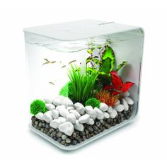 The perfect minimalist accent to any room, apartment or home is this beautiful designed mini Aquarium by BiOrb. Displaying a stylishly built-in LED light and holding up to 15 L, this mini Aquarium is