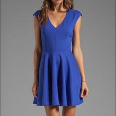 Fit & Flare Dress Prominent seams structure the V-neck bodice and flounced skater skirt of this minimally styled, stretch-knit dress cast in a cool blue hue. Back zip closure. Unlined. 75% polyester, 18% rayon, 7% spandex. Dry clean. By Eight Sixty; made in the USA of imported fabric. Encore. Eight Sixty Dresses