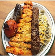 Persian herb rice with kebab (ground beef) and joojeh kebab (bbq chicken)