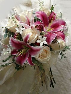 Stephanotis Rose and Stargazer Lily bouquet <3<3<3 this is gorgeous!! After roses...Stargazers are my fav!!!