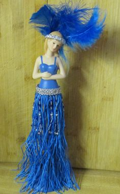 Beads and feathers adorn this Tassel Doll made from a kit......