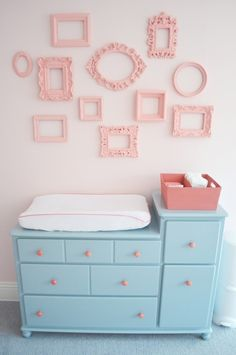 Love the frames. Maybe a white dresser instead...