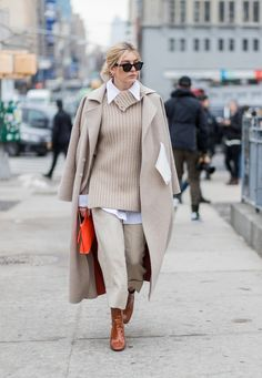 NEW YORK, NY - FEBRUARY 15: Camille Charriere wearing a beige knit, beige wool coat, cropped pants outside Michael Kors on February 15, 2017 in New York City.