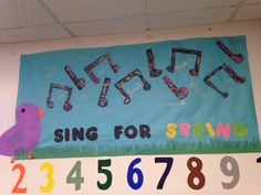 Sing for Spring bulletin board--kiddos cut out music notes, colored them with chalk, and glued sequins on them