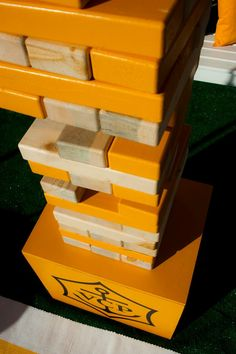one of many wedding games...life size jenga all painted in wedding colors... definitely doing this we all love jenga!