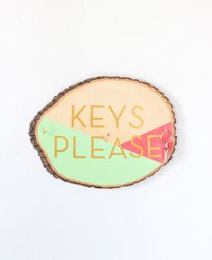 A DIY wall sign that is both colorful and blunt reminds you to hang up your keyring in the same spot every day.