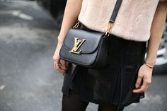 Spotted on the streets of #NYFW, the Vivienne LV handbag. (Photography of Saskia Lawaks for http://www.Vogue.fr)