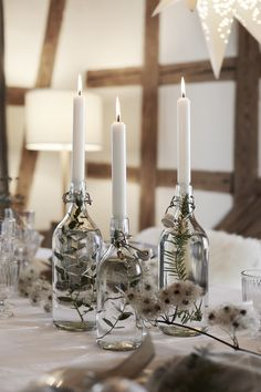 Candles provide a romantic ambience. You can easily create your own eye-catching centrepiece by arranging fir or eucalyptus branches in glass bottles filled with water. Add a simple white candle, and voilà – just like that, you've made an original candlestick for your festively romantic table. #myIKEA #xmas #tablesetting #nordic #winter #style #scandinavian #skandi #candlestick #DIY #candles #home #natural #decoration #interior #christmasdecor #Weihnachten #Weihnachtsdekoration #Tischdeko Christmas Table Settings, Christmas Decorations, Table Decorations, Bottle Candles, Glass Bottles, Candle Centerpieces For Home, Romantic Table, White Candles, Diy Candles