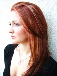 red hair with highlights and lowlights. I had my hair similar to this once but more auburn than bright red. Thinking about going back :)