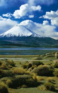 Parinacota volcano is a massive potentially active stratovolcano on the border of Chile and Bolivia. It is part of the Nevados de Payachata volcanic group. The volcano straddles the border between Sajama National Park (Bolivia) and Lauca National Park (Chile).