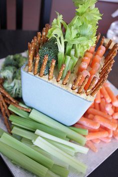 fun planter filled with hummus and various veggies and pretzels for dipping. How cute would this be as your table centerpiece? To pull this off, I used one of my new unused planters (a terra-cotta pot would look super cute too!) and filled the bottom up w...