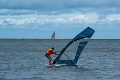 A man surfing on a windy day at the Baltic Sea.